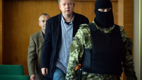 """Detained observers from the Organization for Security and Co-operation in Europe arrive to take part in a news conference Sunday, April 27, in Slovyansk. Vyacheslav Ponomarev, the self-declared mayor of Slovyansk, referred to the observers as """"prisoners of war."""""""