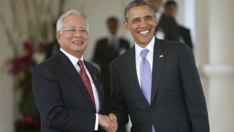 Obama shakes hands with Malaysian Prime Minister Najib Razak as he arrives at Najib's residence in Kuala Lumpur, Malaysia, on Sunday, April 27.