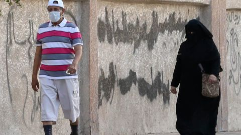 A Saudi man wears a mask as he walks in the city of Jeddah on April 27. Saudi Arabia has recently seen an alarming increase in confirmed cases of Middle East respiratory symptom coronavirus.