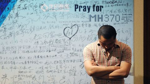 Caption:A man stands in front of a billboard in support of missing Malaysia Airlines flight MH370 as Chinese relatives of passengers on the missing Malaysia Airlines flight MH370 have a meeting at the Metro Park Hotel in Beijing on April 23, 2014. The hunt for physical evidence that the Malaysia Airlines jet crashed in the Indian Ocean more than three weeks ago has turned up nothing, despite a massive operation involving seven countries and repeated sightings of suspected debris.. AFP PHOTO / WANG ZHAO (Photo credit should read WANG ZHAO/AFP/Getty Images)