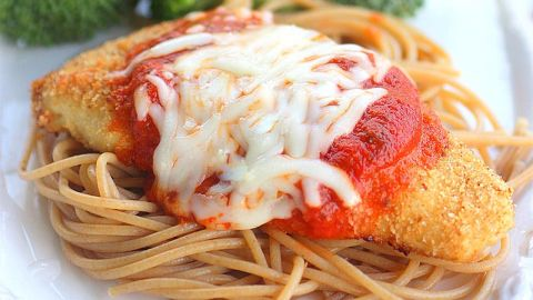 Baked chicken, whole wheat pasta and a side of veggies make for a healthy chicken parmesan.