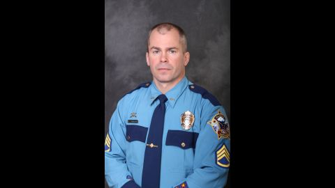 """Sgt. Patrick Johnson was one of two Alaska state troopers who were shot and killed Thursday, May 1, in the remote village of Tanana, Alaska. Johnson and the other victim, Trooper Gabriel Rich, had previously appeared on the National Geographic Channel program """"Alaska State Troopers,"""" the channel said."""