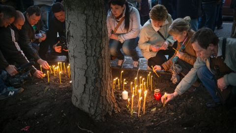 Pro-Russian protesters light candles in Donetsk on Saturday, May 3, to honor the memory of fallen comrades in Odessa.