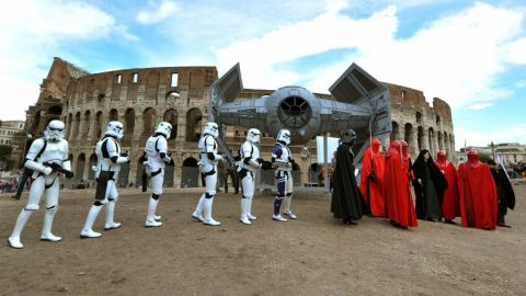 """Members of the """"Star Wars"""" fan club celebrate May 4 (""""Star Wars Day"""") in front of the Colosseum in central Rome. Why May 4? It's related to a pun on """"May the Force be with you"""" -- """"May the Fourth be with you."""""""