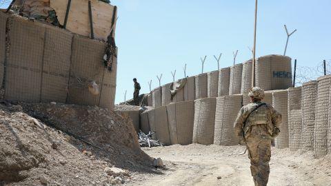 A U.S. soldier patrols outside FOB Shank In Afghanistan.