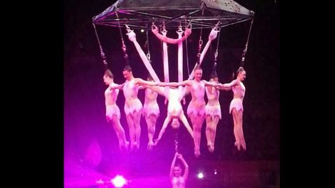 """Click to expand: The """"human chandelier"""" is seen from an earlier performance on Friday, May 2."""