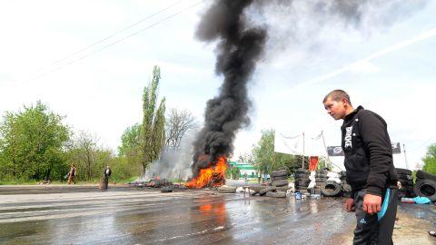 A man walks past burning tires near Kramatorsk on May 3.