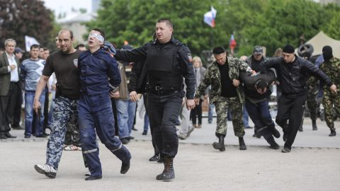 Pro-Russian supporters lead blindfolded men in front of the regional administration building in Donetsk on Monday, May 5.