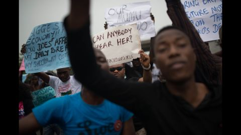 People rally in Lagos on Thursday, May 1.