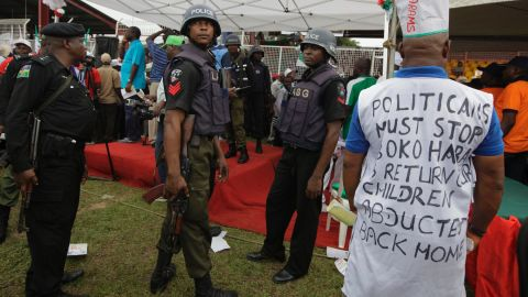 Police stand guard during a demonstration in Lagos on May 1.