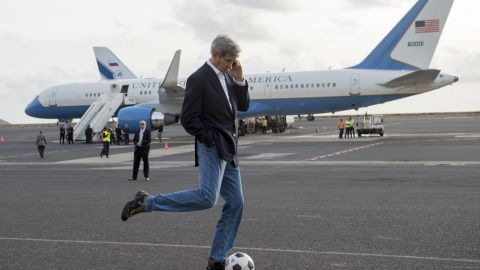 Kerry kicks around a soccer ball during an airplane refueling stop at Sal Island, Cape Verde, on Monday, May 5, 2014. Kerry was on his first major tour of Africa, focusing on some of the continent's most brutal conflicts.