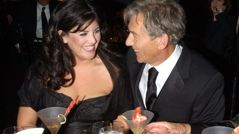 Lewinsky laughs with actor Ian McKellen at the 2002 GQ Men of the Year Awards in New York City.