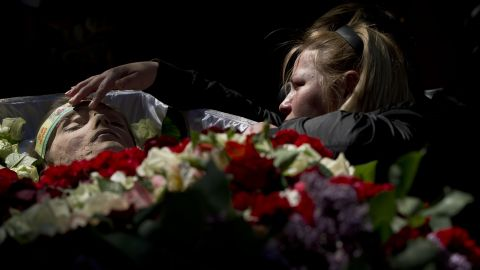 A relative mourns by the body of 17-year-old Vadim Papura during a service in Odessa on May 6. Papura died after jumping out of a burning trade union building during riots on May 2.