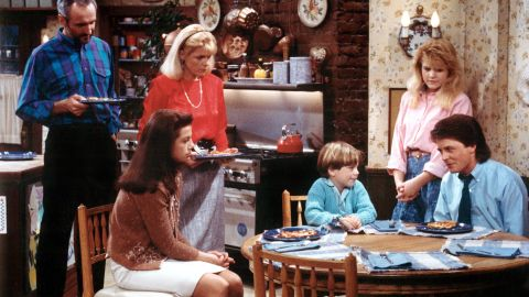 """In """"Family Ties,"""" Elyse Keaton (Meredith Baxter, second from left) juggled life as an architect with a mother's sturdy guidance for her children (from left, Justine Bateman, Brian Bonsall, Tina Yothers and Michael J. Fox). Husband Steven (Michael Gross, far left) was an equal partner."""