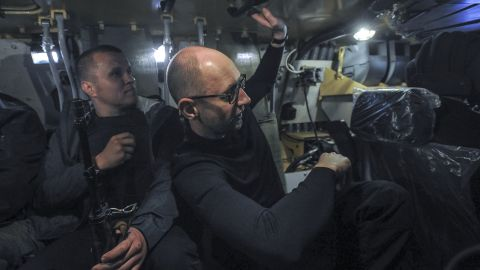 Ukrainian Prime Minister Arseniy Yatsenyuk, right, inspects an armored personnel carrier in Slovyansk on May 7.