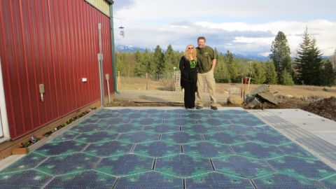 Solar Roadways co-founders Julie and Scott Brusaw stand on their prototype parking lot. Their idea calls for solar-powered roadways made of durable textured glass.