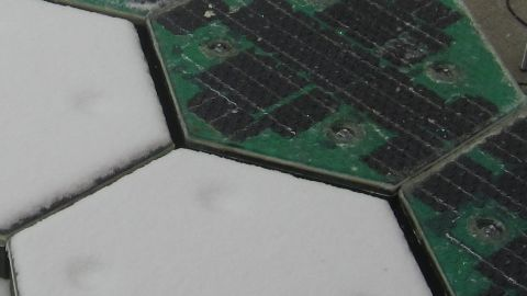 This invention could allow roads to be quickly cleared of snow. The panels on the right are switched on, and the left ones switched off.