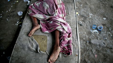 A drug user rests beneath an overpass in a Rio shantytown.