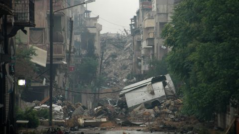 Debris lies on a deserted street in Homs on Thursday, May 8.