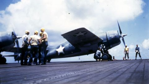 Navy personnel work on board the USS Ranger circa 1942. The Ranger was the first ship to be designed and built specifically as an aircraft carrier. It was the only ship in its class.
