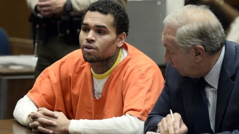 """<strong>May 2014: </strong><a href=""""http://www.cnn.com/2014/05/09/showbiz/chris-brown-jail/index.html"""" target=""""_blank"""">Brown appears in court</a> for a probation violation hearing on May 9. He admitted to violating his probation and was ordered by a judge to serve one year in jail."""