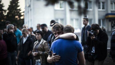 Two men react after Ukrainian national guardsmen open fire on a crowd outside a town hall in Krasnoarmiysk, Ukraine, on May 11.