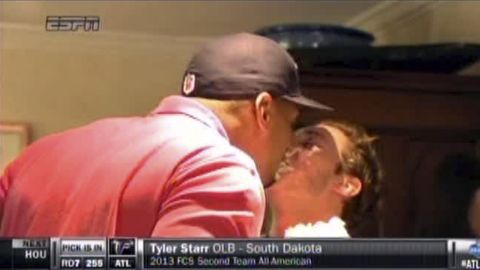 In an image taken from video, Michael Sam, left, and boyfriend Vito Cammisano kiss at an NFL draft party in San Diego. Sam was selected in the seventh round, 249th overall, by the St. Louis Rams.