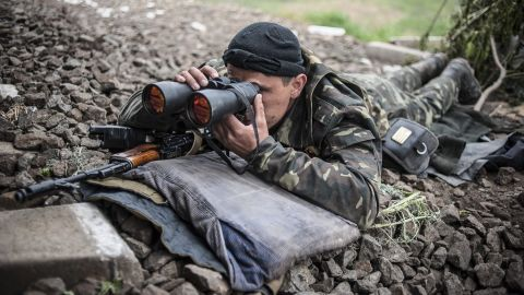 An armed pro-Russian separatist takes up a position near Slovyansk on May 12.