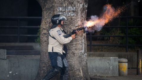 A member of the Bolivarian National Police clashes with protestors during a demonstration against Venezuelan President Nicolas Maduro in Caracas on Saturday, May 10. Clashes between anti-government protesters and security forces have left more than 40 people dead and about 800 injured since February, according to officials.