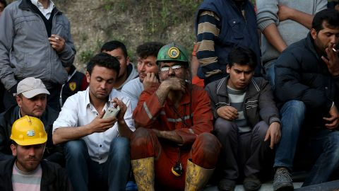 """Miners and relatives wait outside the mine on May 13. Turkish Energy Minister Taner Yildiz said officials turned an exit pipe """"into a clean air pipe,"""" so """"there is fresh air being given in places where there is no fire."""""""
