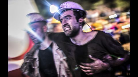 An injured miner gets pulled from the mine on May 13.
