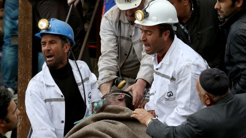 A miner is helped by rescue workers from the coal mine on May 14, 2014 in Soma, Manisa, Turkey.