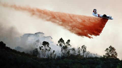 A plane drops fire retardant over a hot spot in San Marcos on May 14.