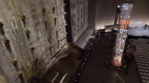 """The symbolic """"Last Column,"""" right, a steel beam from one of the towers, stands near the """"slurry wall,"""" left, which holds back the Hudson River waters."""