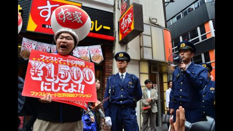 Labor union members strike in front of a McDonald's in Tokyo on May 15.