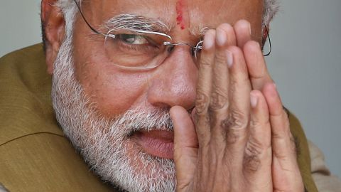 Opposition Bharatiya Janata Party (BJP) leader and India's next prime minister Narendra Modi greets the gathering at the home of his 90-year-old mother in Gandhinagar, in the western Indian state of Gujarat, Friday, May 16, 2014. Modi won the most decisive election victory the country has seen in more than a quarter century and swept the long-dominant Congress party from power, partial results showed Friday. (AP Photo/Saurabh Das)