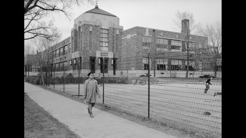 """Linda Brown, 9, walks past Sumner Elementary School in Topeka, Kansas, in 1953. Her enrollment in the all-white school was blocked, leading her family to bring a lawsuit against the Topeka Board of Education. Four similar cases were combined with the Brown complaint and presented to the US Supreme Court as <a href=""""http://www.cnn.com/2013/07/04/us/brown-v-board-of-education/index.html"""">Brown v. Board of Education.</a> The court's landmark ruling on the case on May 17, 1954, led to the desegregation of the US education system."""