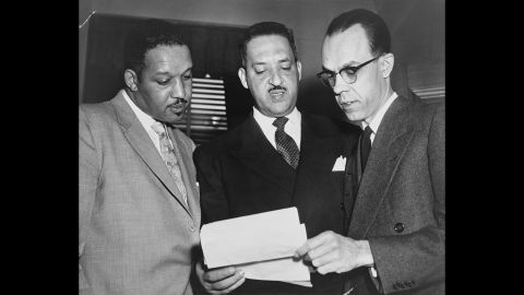 From left, lead lawyers Harold P. Boulware, Thurgood Marshall and Spottswood W. Robinson III confer at the US Supreme Court prior to presenting arguments in 1953. Marshall, the NAACP's Special Counsel and lead counsel for the plaintiffs, argued the case before the Supreme Court.