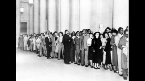 People wait in line outside the Supreme Court during the hearings in 1953.