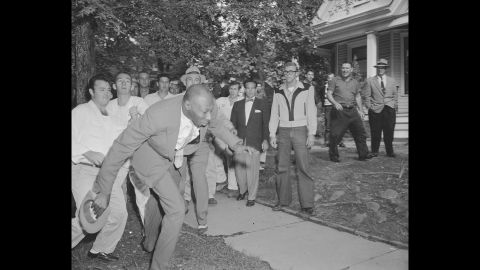 Alex Wilson, a reporter from the Tri-State Defender, is shoved by an angry mob of white people near Central High School in Little Rock, Arkansas, on September 23, 1957. The fight started when nine black students gained entrance to the school as the US Army enforced integration.
