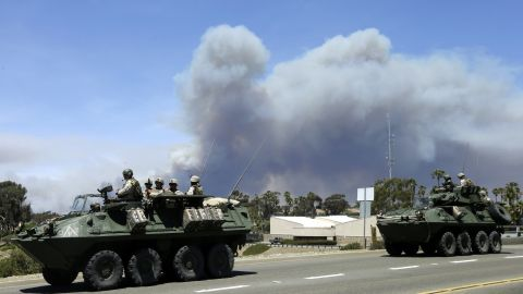 Marines move military vehicles near the entrance to Camp Pendleton on May 16.