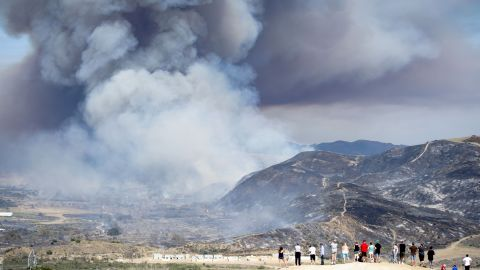 Residents watch the wildfire near San Diego on Friday, May 16.