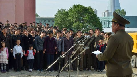 A North Korean official apologizes on Saturday, May 17, in front of residents and families of victims of an accident at an apartment construction site in Pyongyang, North Korea.