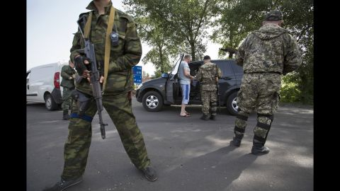 Pro-Russian armed militants guard a checkpoint in Slovyansk on May 19, blocking a major highway to Kharkiv.