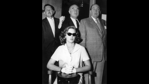 In 1958, a then-14-year-old Cheryl Crane, daughter of actress Lana Turner, stabbed her mother's boyfriend, Johnny Stompanato. Crane told police that Stompanato, who had ties to organized crime, had threatened her mother with a knife. Here, Crane is shown with three unidentified men at the time of her trial, which resulted in a ruling of justifiable homicide.