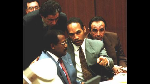 Probably one of the most famous cases ever involving a celebrity,  O.J. Simpson, center, was arrested for the murders of his ex-wife, Nicole Brown Simpson, and her friend Ron Goldman in 1994. Here he confers with attorneys Johnnie Cochran, left, and Robert Shapiro during a hearing in 1995. Simpson's friend Robert Kardashian stands behind him. Simpson, a former pro football player, was acquitted in the criminal case.