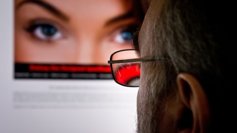 Caption:TO GO WITH AFP STORY US-LIFESTYLE-LOVE-INTERNET-ADULTERY BY FABIENNE FAUR A man looks at a dating site on his computer in Washington,DC on February 10, 2014. One 29-year-old woman says it helped her take revenge on her unfaithful husband. A 45-year-old married man says it has helped prevent the break-up of his family. For millions, adultery via the Internet has become the new normal. Since the launch of the Canada-based Ashley Madison website in 2002, which created a sensation with its seductive slogan 'Life is short, have an affair,' the numbers turning to online infidelity have soared. There are now dozens of similar websites offering the promise of extramarital relationships with domain names that are unabashedly direct, from www.datingforcheaters.com to www.heatedaffairs.com. For Noel Biderman, the founder of Ashley Madison, his site and others like it are merely facilitating a human desire that is as old as time. AFP PHOTO/EVA HAMBACH (Photo credit should read EVA HAMBACH/AFP/Getty Images)