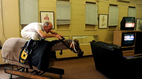 He works tirelessly to get himself in shape -- here he tackles a mechanical horse to prepare himself for racing.