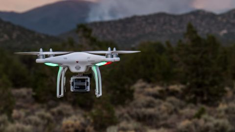 A DJI Phantom drone captured in action.