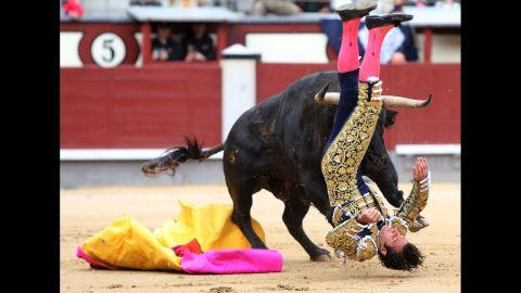 Mora flips upside down as he is hit.